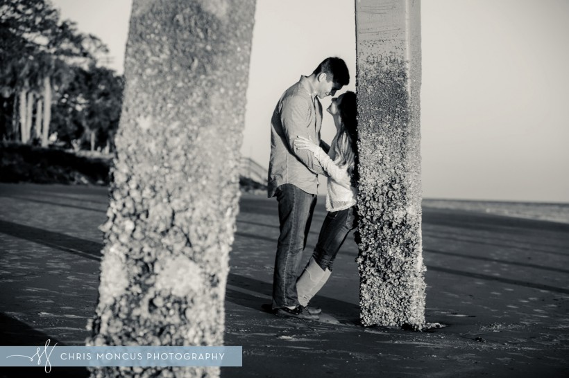 Snuggling Under the Pier Engagement Session